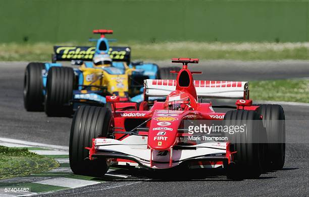 Michael Schumacher of Germany and Ferrari leads Fernando Alonso of Spain and Renault during the San Marino Formula One Grand Prix at the San Marino...
