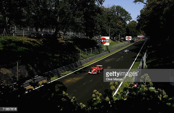 Michael Schumacher of Germany and Ferrari leads Fernando Alonso of Spain and Renault during qualifying for the Italian Grand Prix at the Autodromo...
