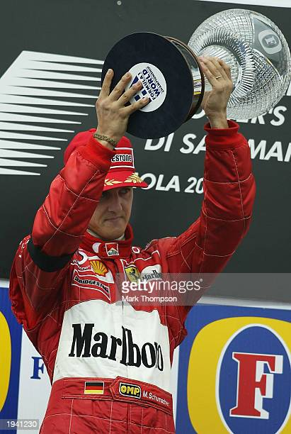 Michael Schumacher of Germany and Ferrari lifts the trophy after winning the Formula One the Formula One San Marino Grand Prix on April 20, 2003 at...