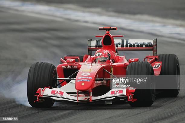Michael Schumacher of Germany and Ferrari locks a wheel during the Formula One Brazilian Grand Prix at Interlagos on October 24 2004 in Sao Paulo...