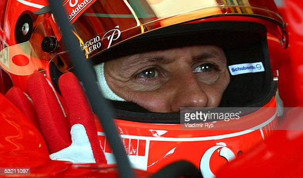 Michael Schumacher of Germany and Ferrari looks on during practice for the British F1 Grand Prix on July 8 2005 in Silverstone England