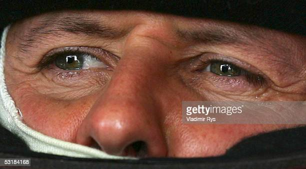 Michael Schumacher of Germany and Ferrari looks on during the qualifying for the French F1 Grand Prix at Magny Cours on July 2, 2005 in Magny Cours,...