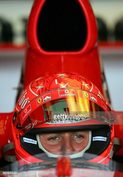 Michael Schumacher of Germany and Ferrari looks on from his car during testing at Circuito de Jerez on January 11 2006 in Jerez Spain