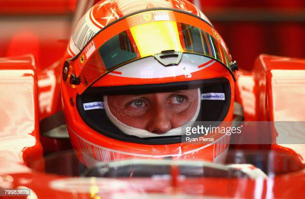 Michael Schumacher of Germany and Ferrari looks on from the pits during day one of the Formula One Testing at the Circuit de Catalunya on February 25...