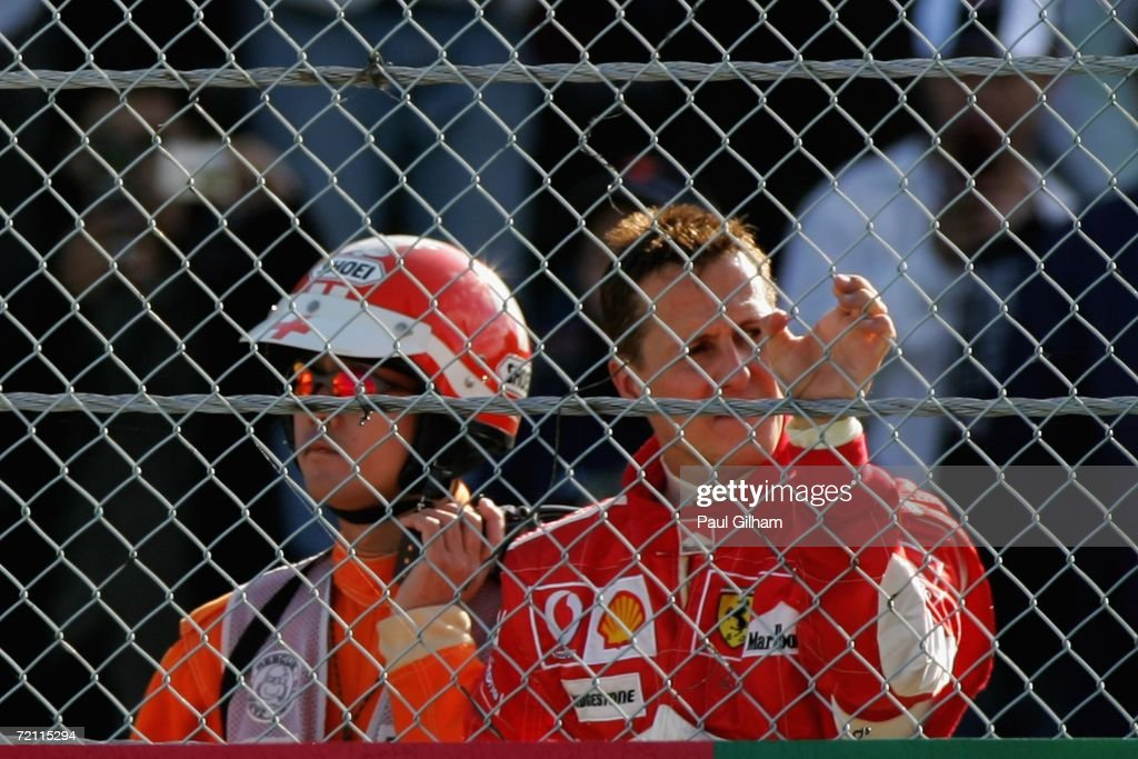 Michael Schumacher of Germany and Ferrari looks on from the side of the track after his engine failed and he retired from the race during the Japanese Formula One Grand Prix at Suzuka Circuit on October 8, 2006 in Suzuka, Japan.