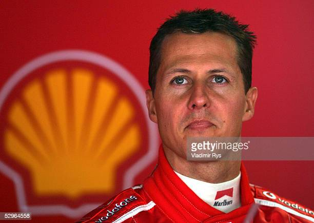 Michael Schumacher of Germany and Ferrari looks on in the Ferrari pit during the qualifying session for the Monaco Formula One Grand Prix on May 22...