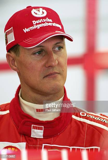 Michael Schumacher of Germany and Ferrari looks on in the team garage during first practice for the Turkish Formula One Grand Prix at Istanbul Park...