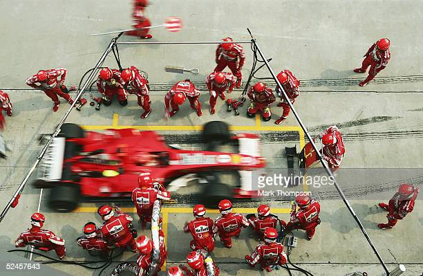 Michael Schumacher of Germany and Ferrari makes a pit stop during the Malaysian Formula One Grand Prix at Sepang Circuit on March 20 2005 in Kuala...