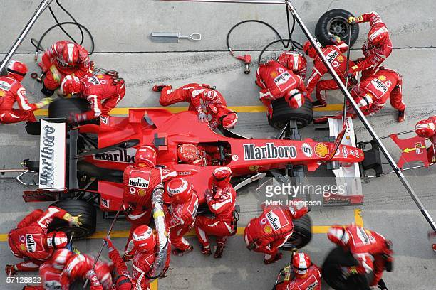 Michael Schumacher of Germany and Ferrari makes a pit stop during the Malaysian Formula One Grand Prix at the Sepang Circuit on March 19 in Kuala...