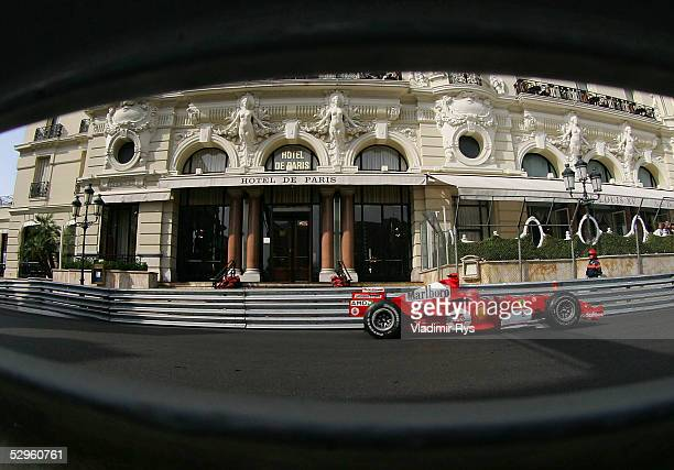 Michael Schumacher of Germany and Ferrari passes in front of the Hotel de Paris during the practice session for the Monaco Formula One Grand Prix on...