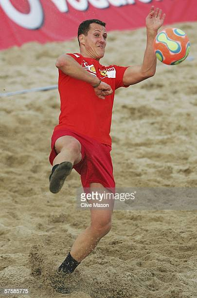 Michael Schumacher of Germany and Ferrari plays beach soccer during the previews to the Spanish Formula One Grand Prix at the Circuit De Catalunya on...