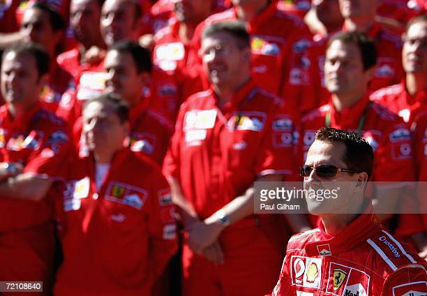 Michael Schumacher of Germany and Ferrari poses with his teammates including Jean Todt and Ross Brawn for the Ferrari team shot prior to practice...