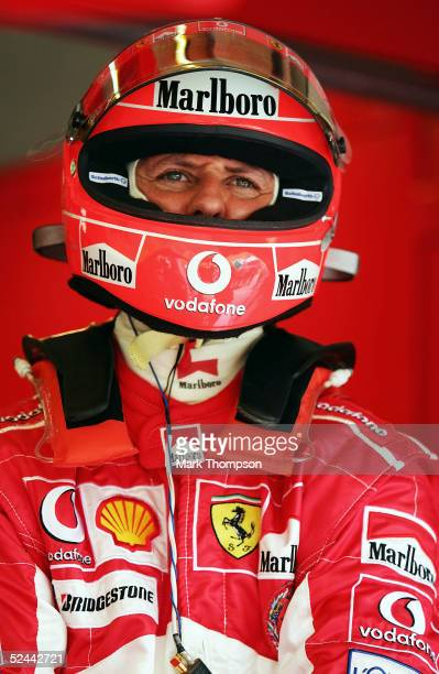 Michael Schumacher of Germany and Ferrari prepares for practice for the Malaysian Formula One Grand Prix at Sepang Circuit on March 18 2005 in Kuala...