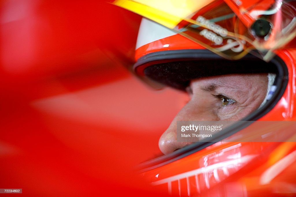 Michael Schumacher of Germany and Ferrari prepares in the garage for the practice round before the qualifying session of the Brazilian Formula One Grand Prix at the Autodromo Interlagos on October 21, 2006 in Sao Paulo, Brazil.