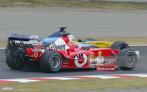 Michael Schumacher of Germany and Ferrari returns to the pits with a damaged nose cone during the Formula One Japanese Grand Prix in Suzuka on...