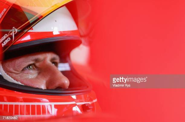 Michael Schumacher of Germany and Ferrari sits in his car during the second practice session for the Italian Formula One Grand Prix at the Autodromo...
