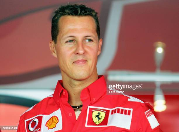 Michael Schumacher of Germany and Ferrari smiles after the Vodafone Race on Piazza Duomo in Milan during the preview to the Italian F1 Grand Prix on...