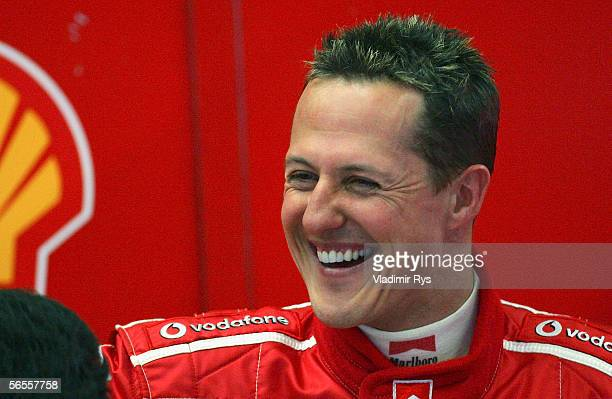 Michael Schumacher of Germany and Ferrari smiles in the garage after crashing during F1 testing at Circuito de Jerez on January 10 2006 in Jerez Spain