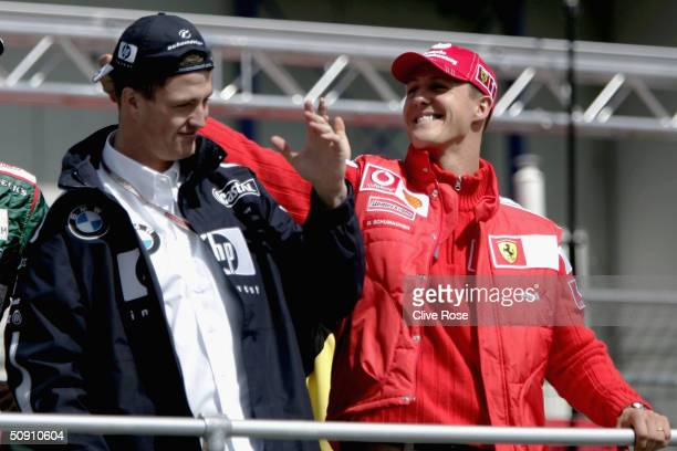 Michael Schumacher of Germany and Ferrari steal's Ralf Schumachers cap during the drivers parade prior to the European F1 Grand Prix on May 30 at the...