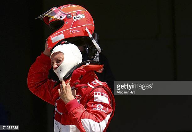 Michael Schumacher of Germany and Ferrari takes off his helmet after finishing fifth during qualifying for the Canadian Formula One Grand Prix at the...