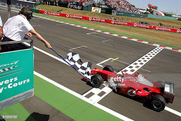 Michael Schumacher of Germany and Ferrari takes the chequered flag during the French F1 Grand Prix at the MagnyCours Circuit on July 4 in MagnyCours...
