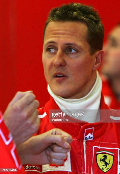 Michael Schumacher of Germany and Ferrari talks with technicians during testing at Circuito de Jerez on January 11 2006 in Jerez Spain