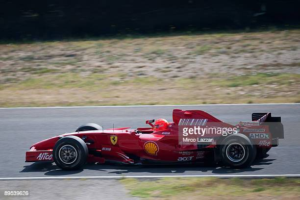 Michael Schumacher of Germany and Ferrari tests the Ferrari F2007 at the Mugello Circuit on July 31, 2009 in Scarperia, Italy. Schumacher retired...