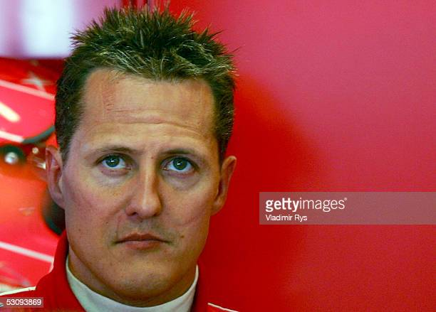 Michael Schumacher of Germany and Ferrari waits in his garage after the practice for the US F1 Grand Prix on June 17, 2005 in Indianapolis, Indiana.