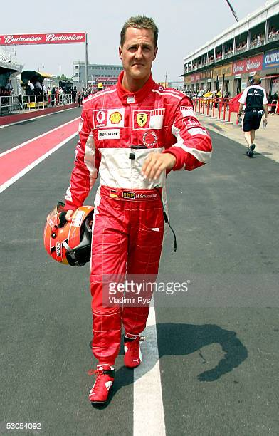 Michael Schumacher of Germany and Ferrari walks on pit lane after qualifying for the second position during the qualifying for the Canadian F1 Grand...