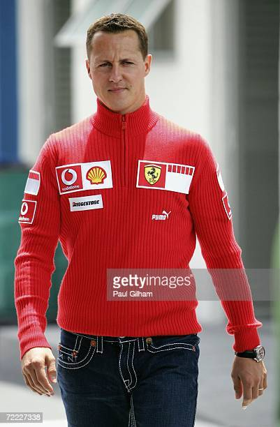 Michael Schumacher of Germany and Ferrari walks through the paddock during first practice for the Brazilian Formula One Grand Prix at the Autodromo...