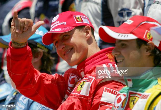 Michael Schumacher of Germany and Ferrari waves to the crowd as teammate Felipe Massa of Brazil looks on before the Brazilian Formula One Grand Prix...
