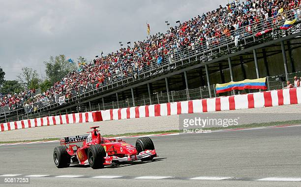 Michael Schumacher of Germany and Ferrari waves to the crowd to celebrate winning the Barcelona F1 Grand Prix on May 9 at the Circuit de Catalunya in...