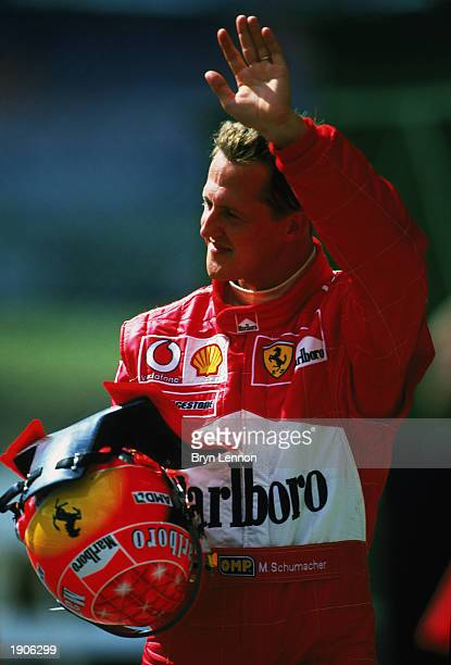 Michael Schumacher of Germany and Ferrari waving to fans during the Formula One Brazilian Grand Prix held on April 6, 2003 at Interlagos, Sao Paulo,...