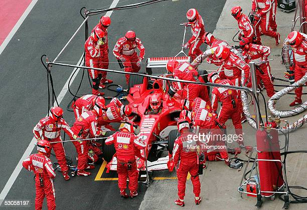 Michael Schumacher of Germany and Ferrari with his machanics for a pit stop the Canadian F1 Grand Prix at the GillesVilleneuve Circuit on June 12...
