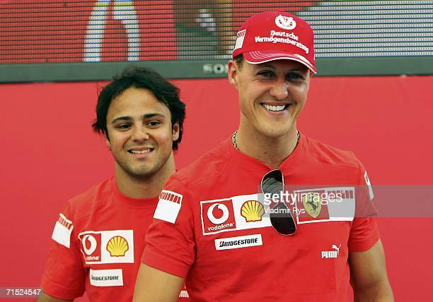 Michael Schumacher of Germany and his team mate Felipe Massa of Brazil and Ferrari attend at the Vodafone Racing Djs event in Heidelberg during the...