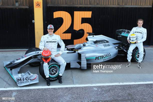 Michael Schumacher of Germany and Mercedes GP and Nico Rosberg of Germany and Mercedes GP attend the roll out of the new Mercedes W01 at the Ricardo...