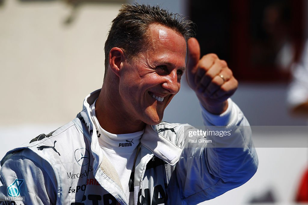 Michael Schumacher of Germany and Mercedes GP celebrates in parc ferme after finishing third during the European Grand Prix at the Valencia Street Circuit on June 24, 2012 in Valencia, Spain.