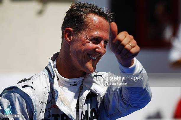 Michael Schumacher of Germany and Mercedes GP celebrates in parc ferme after finishing third during the European Grand Prix at the Valencia Street...