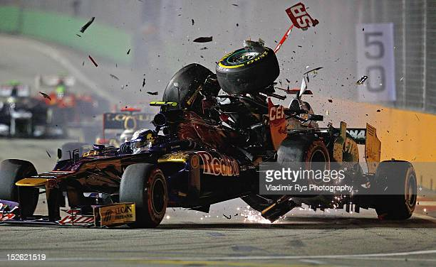 Michael Schumacher of Germany and Mercedes GP crashes with JeanEric Vergne of France and Scuderia Toro Rosso during the Formula One Grand Prix of...