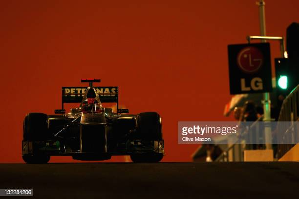 Michael Schumacher of Germany and Mercedes GP drives down the pitlane during practice for the Abu Dhabi Formula One Grand Prix at the Yas Marina...