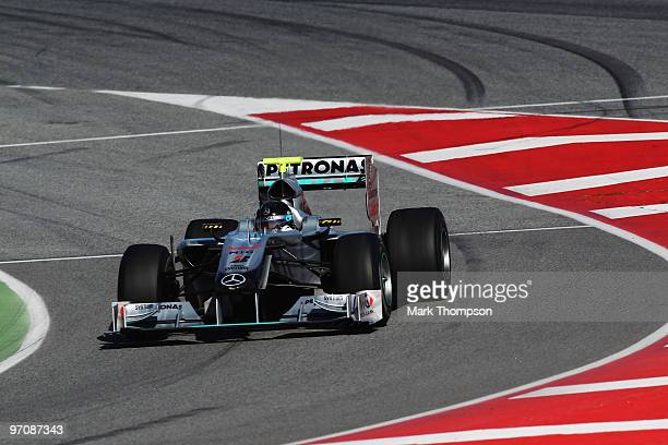 Michael Schumacher of Germany and Mercedes GP drives during Formula One winter testing at the Circuit De Catalunya on February 26, 2010 in Barcelona,...