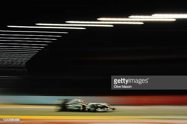 Michael Schumacher of Germany and Mercedes GP drives during practice for the Singapore Formula One Grand Prix at the Marina Bay Street Circuit on...