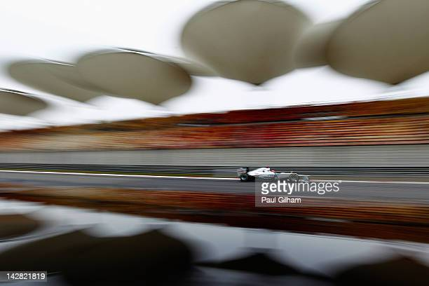 Michael Schumacher of Germany and Mercedes GP drives during practice for the Chinese Formula One Grand Prix at the Shanghai International Circuit on...