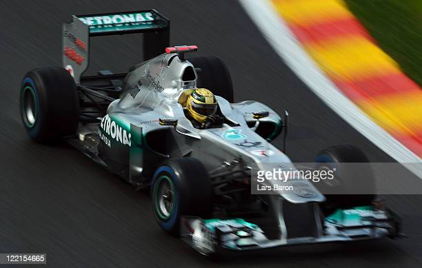 Michael Schumacher of Germany and Mercedes GP drives wearing a specially designed helmet as he commemorates the 20th anniversary of his first F1 race...