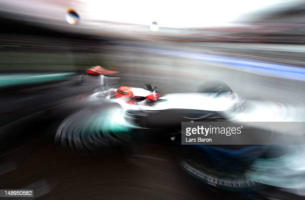 Michael Schumacher of Germany and Mercedes GP exits his garage to drive in the wet conditions during practice for the German Grand Prix at...