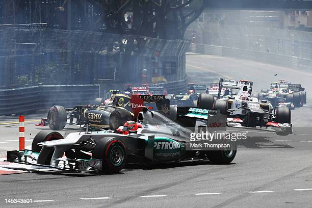 Michael Schumacher of Germany and Mercedes GP goes round the first corner while in the background Kamui Kobayashi of Japan and Sauber F1 is launched...