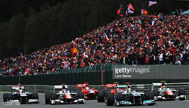 Michael Schumacher of Germany and Mercedes GP heads a group of cars during the Belgian Formula One Grand Prix at the Circuit of Spa Francorchamps on...