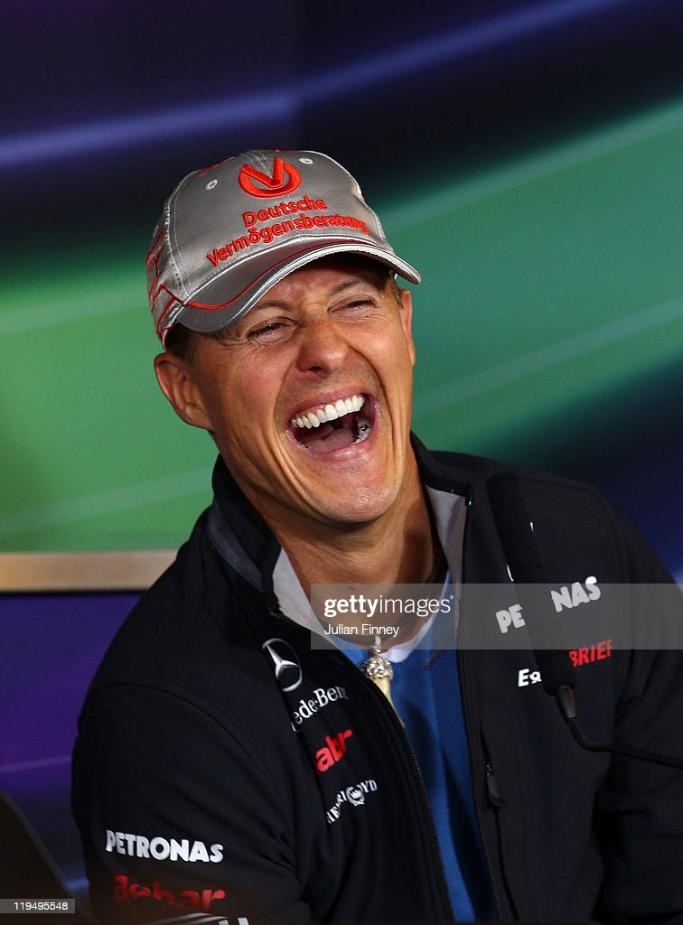 Michael Schumacher of Germany and Mercedes GP laughs while attending the drivers press conference during previews to the German Formula One Grand Prix at the Nurburgring on July 21, 2011 in Nurburg, Germany.