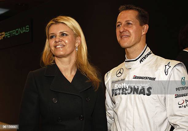 Michael Schumacher of Germany and Mercedes GP Petronas talks with his wife Corrina during the Mercedes GP Petronas Formula One Team presentation at...
