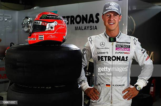 Michael Schumacher of Germany and Mercedes GP poses for a photograph before qualifying for the Brazilian Formula One Grand Prix at the Interlagos...